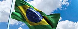Brazilian flag in front of blue sky